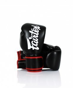 "Fairtex BGV14 Boxing Gloves. Image of black Fairtex microfiber boxing gloves. The gloves are solid color with the ""Fairtex"" brand logo written across the back of the gloves."