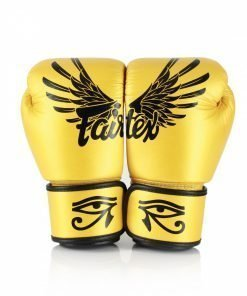 "Fairtex Falcon Boxing Gloves BGV1. Image of gold boxing gloves with Eye of Horus across the wrist strap. There are Falcon Wing and the brand ""Fairtex"" across the back of the boxing gloves."