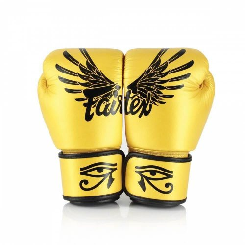 """Fairtex Falcon Boxing Gloves BGV1. Image of gold boxing gloves with Eye of Horus across the wrist strap. There are Falcon Wing and the brand """"Fairtex"""" across the back of the boxing gloves."""