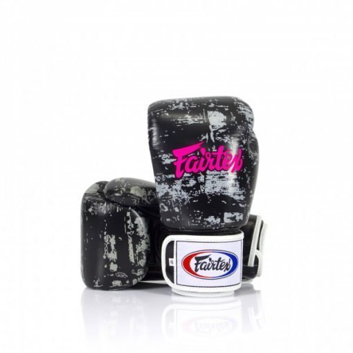 """Fairtex Dark Cloud Boxing Gloves. Image of black/grey boxing gloves, with hot pink """"Fairtex"""" lettering written across the back of the hand."""