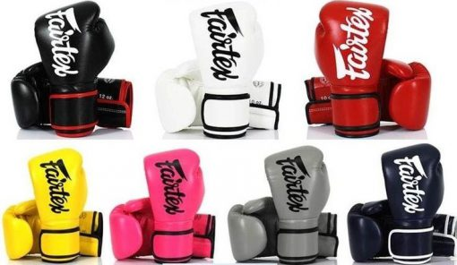 """Fairtex BGV14 Boxing Gloves. Image of Fairtex microfiber boxing gloves. The gloves are solid color with the """"Fairtex"""" brand logo written across the back of the gloves. There are 7 pairs of gloves; they are black, white, red, yellow, pink, grey, and blue."""